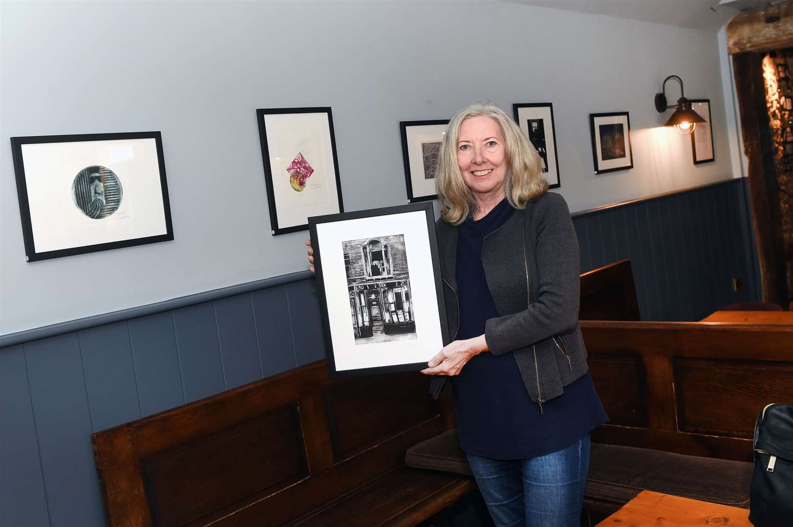 Alison Hart-Arkley with work by the Making Space at Oakes Barn group which is due to be exhibited in the pub. Picture by Mecha Morton