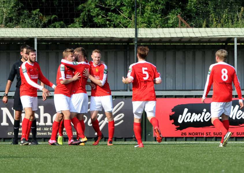 DERBY DELIGHT: Danny Crow is mobbed by team-mates after scoring Mildenhall's second goal at Sudbury