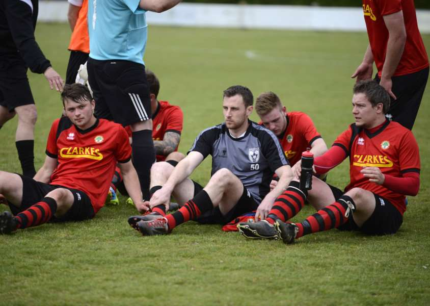 DEJECTED: Walsham-le-Willows players face up to losing their Challenge Cup final at Diss Town