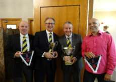 TROPHY TIME: Andy Squire, Martin Kingdon, Neil Clark, and Lou Handy picked up the Marshall Hatchick Two Counties Championship Division Three and Five titles won by Mildenhall Cricket Club this year