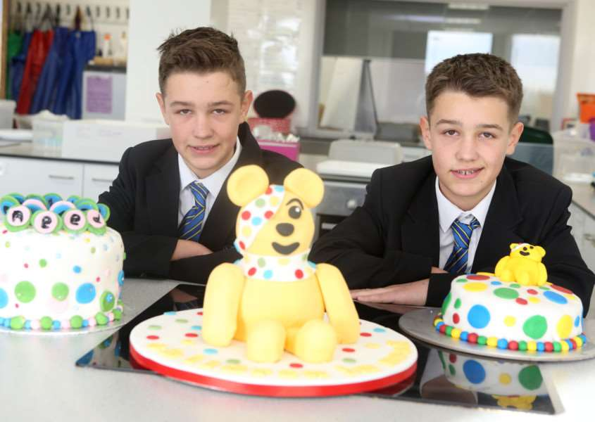 (L-R)James Bayley and Matthew Bayley, both 12, from Thomas Gainsborough School in Great Cornard with some of the winning cakes from the Children in Need cake competition ANL-161118-170014009