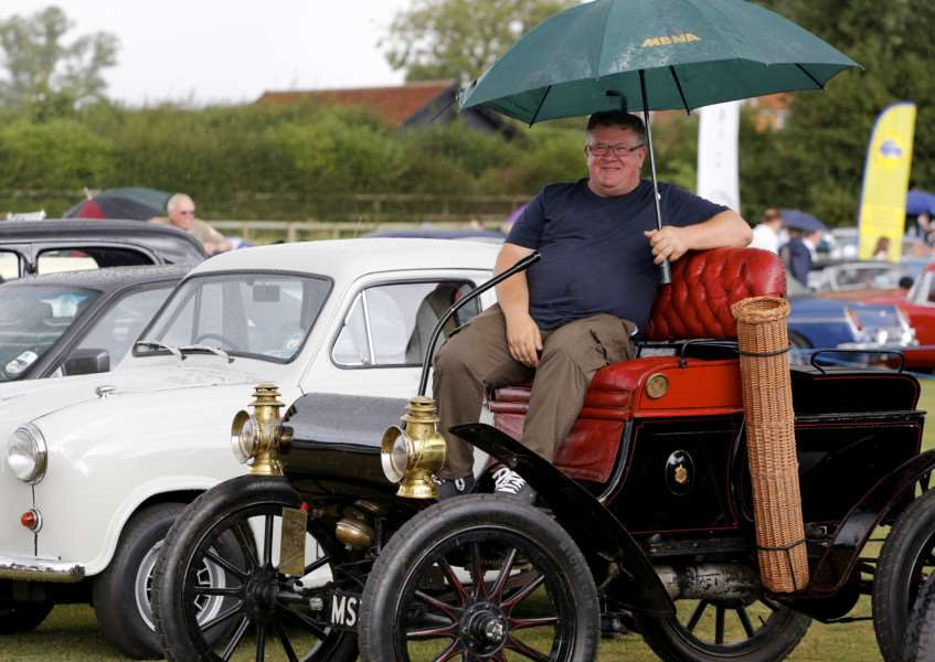 Lavenham, Suffolk. Lavenham Carnival at the recreational ground on Sunday. Pictured is Paul Kelling from Sudbury in his 1903 Oldsmobile. ''Picture: MARK BULLIMORE ANL-160828-203416009