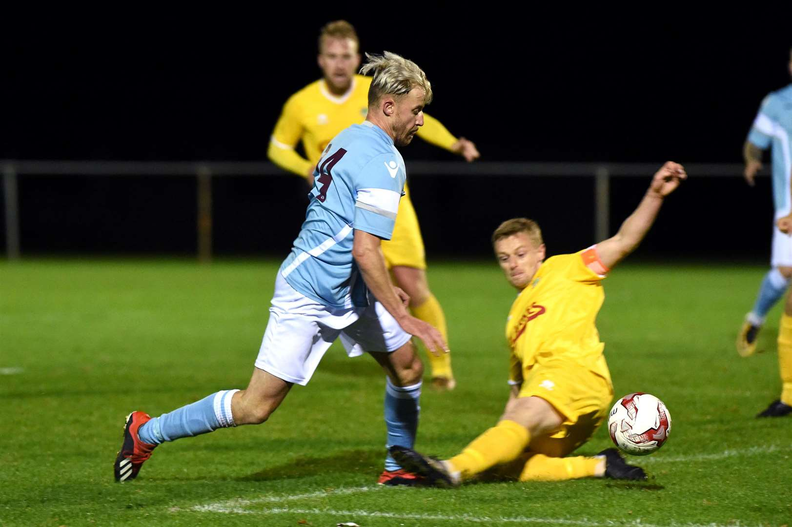FOOTBALL - Walsham Le Willows v Thetford Town..Pictured: Liam Hemming (T) is bought down in the box by Sam Peters (W) and a penalty is awarded...PICTURE: Mecha Morton .... (19344332)
