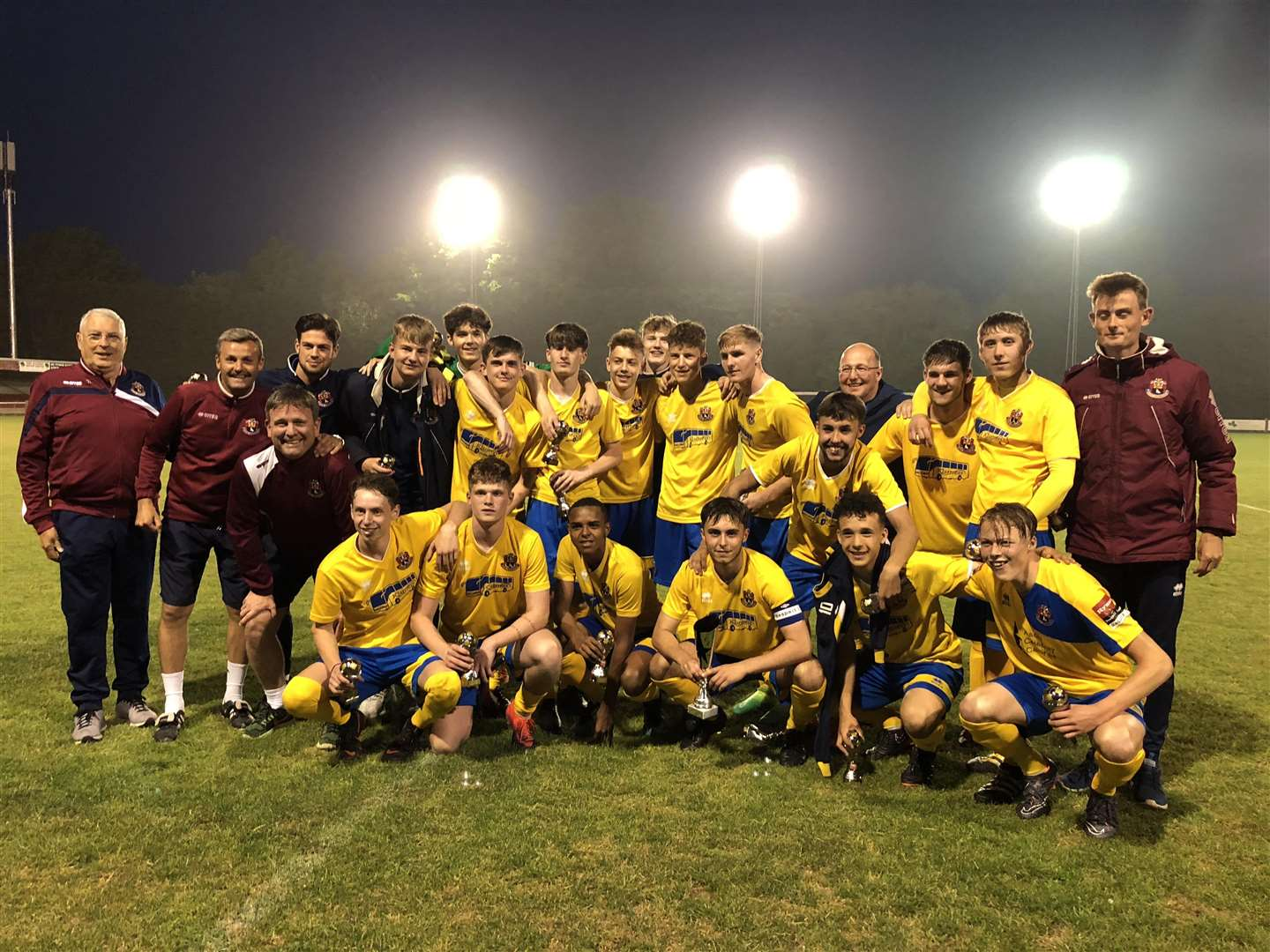 JUBILATION: AFC Sudbury's Under-18s side celebrate on the pitch at Diss Town (2287094)