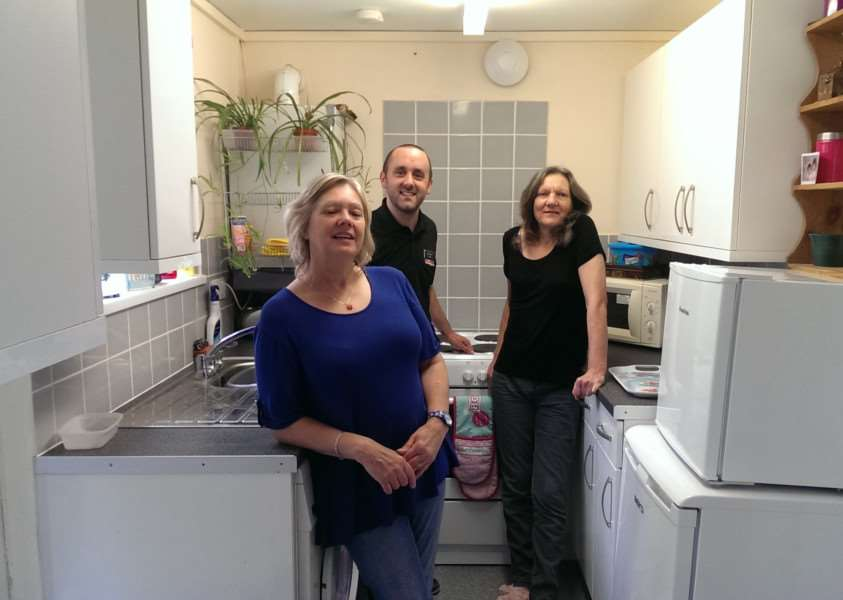 From left: Ann Allen, from REACH Community Projects and Sam Potter, manager of Hughes Electrical with Jayne Hornsey in her kitchen, complete with the donated cooker