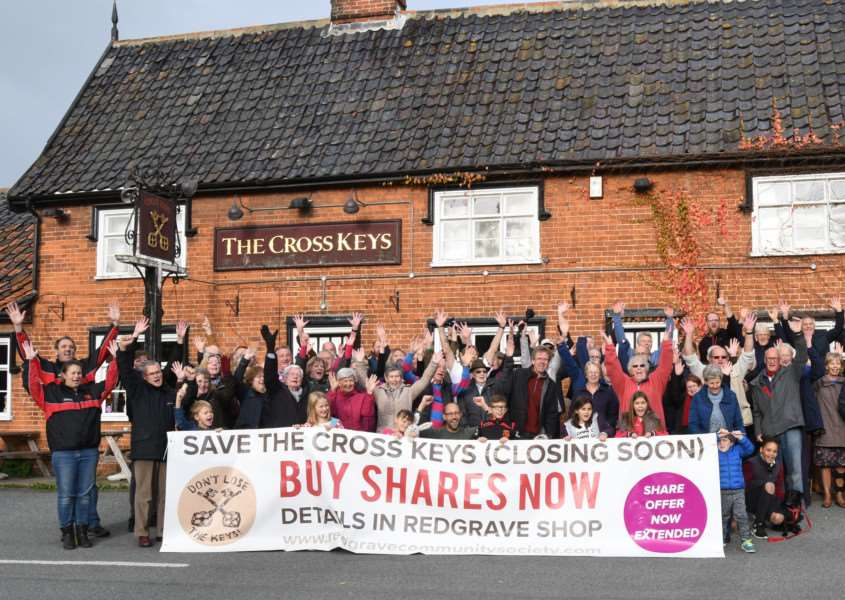 Crowds gather outside the Cross Keys pub in Redgrave to celebrate the purchase of the Grade II Listed building being agreed in principle. Picture: Elaine Brown.