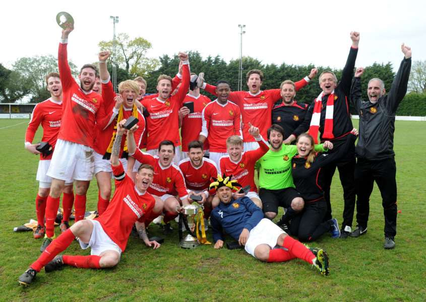 CUP WINNERS: Mildenhall celebrate last season's cup final over Norwich United, with Simpson holding the trophy (centre). Hall play neighbours Newmarket in this year's final.