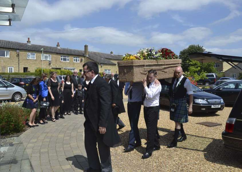 The pallbearers carry Paul McManus' coffin in to St Felix Church at his funeral service ANL-150722-125835001