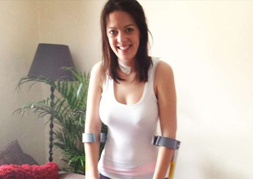 michelle parry feature - michelle on crutches after one of her operations ANL-160626-180353001