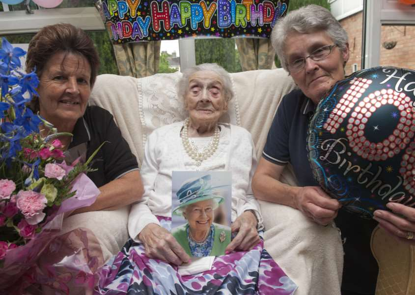 Muriel Daisy Bloomfield celebrating her 100th birthday, in Hazell Court Sudbury pictured with carers Kay Goodson and Pauline Murcott. Picture Mark Westley ANL-150625-000346009