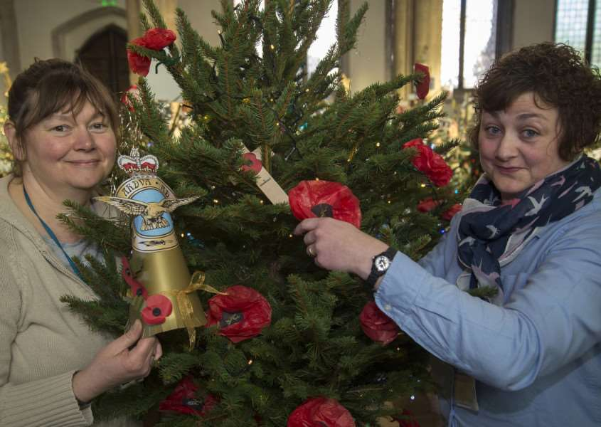 Christmas Tree Festival St Peter's Sudbury. Kay Harling and Hayley Totman LSA's at Hillside Special School putting up the school's Battle of Britain tree. Picture Mark Westley ANL-150912-113925009