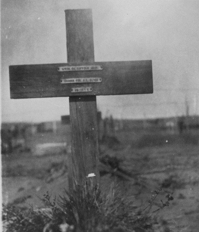 The photograph of the cross initially placed on Jack's grave, the only evidence his parents had of their son's final resting place