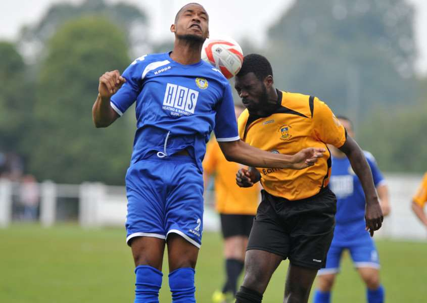 HEADS UP: Stowmarket's Remell Davis (right) challenges for the ball during their FA Vase second qualifying round defeat to Hertford Town at the weekend