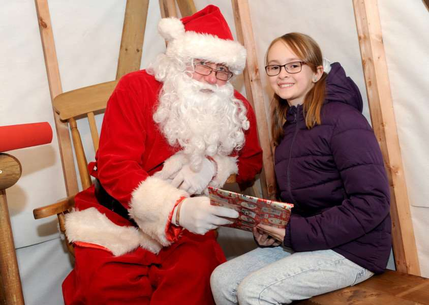 Lilly Arrow Smith, age 10, visiting Santa ANL-161128-080307009