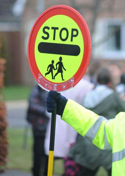School crossing patrols could be axed! Pictured is Lollipop man Bill Cammell outside Westley Middle School on Oliver Road in Bury.