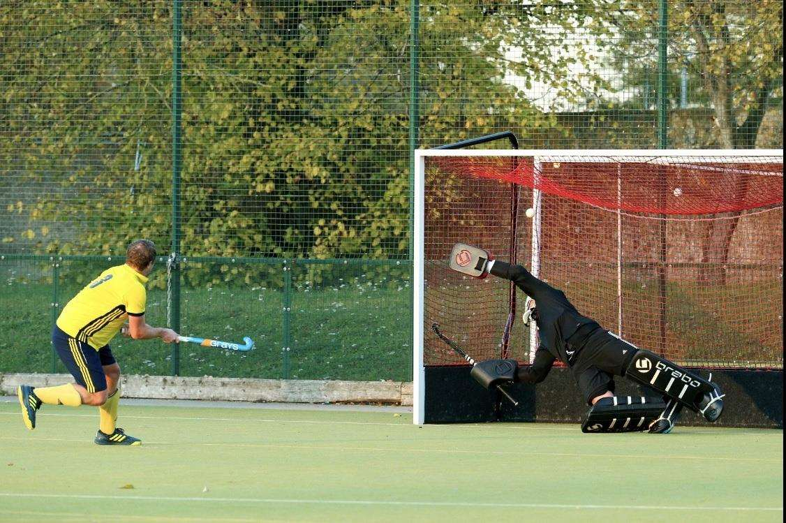 Newmarket Men's I captain Will Wilson scores a penalty flick against Harleston Magpies III (5197565)