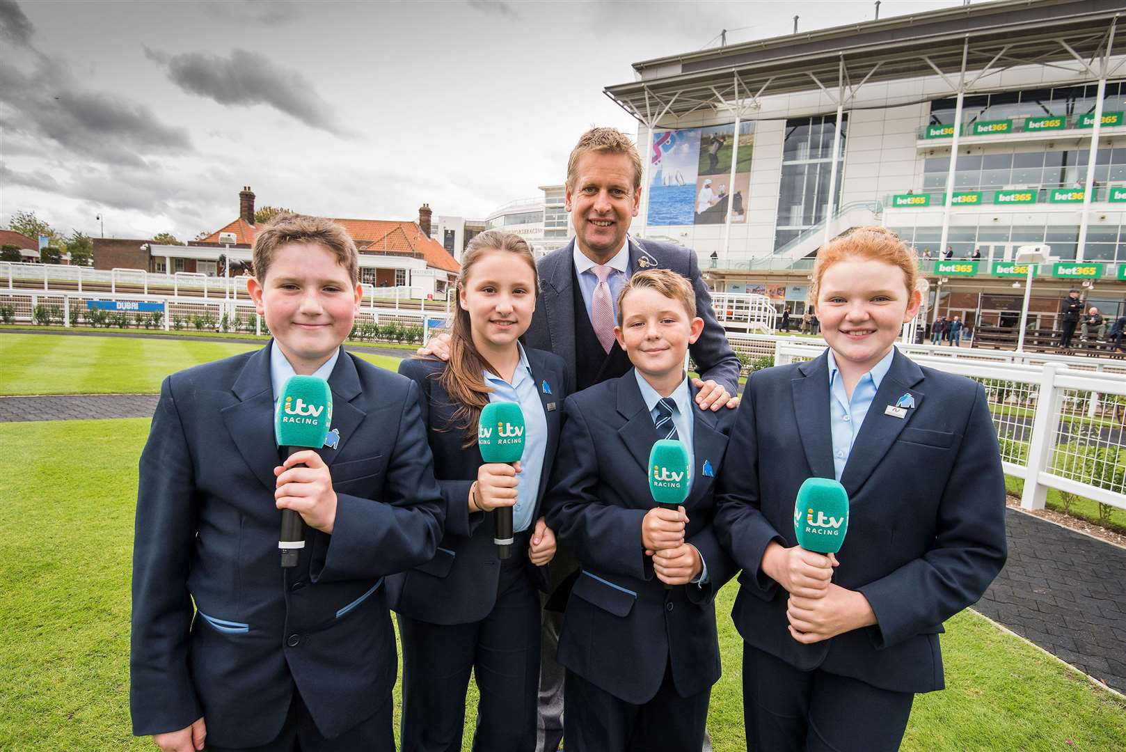 Newmarket Academy Godolphin Beacon Project Racing To School Education week Dubai Future Champions Festival The Newmarket Academy Godolphin Beacon Project Cornwallis Stakes. Students with ITV racing presenters Ed Chamberlin and Francesca Cumani.Picture Mark Westley. (34947002)