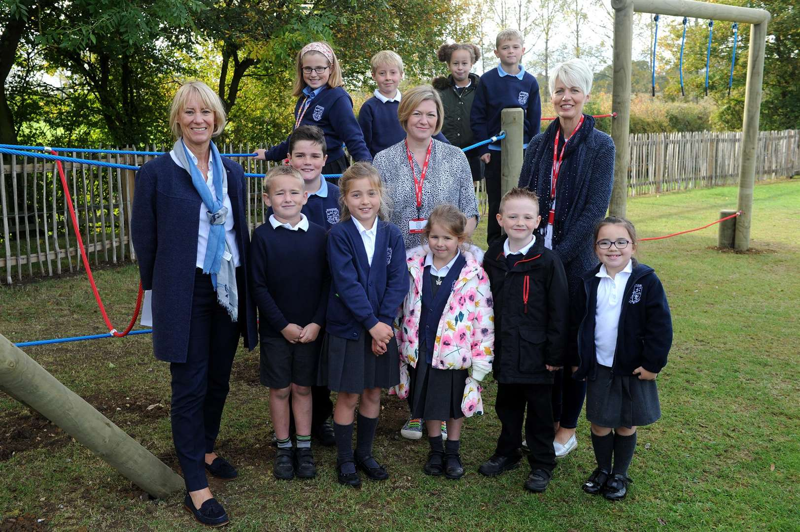 Opening of new play area at Rougham Primary School..Pictured: Pupils with Head Teacher Diane Grimes, PTA members Becky Broughton and Katie Blute....PICTURE: Mecha Morton... .. (4670448)