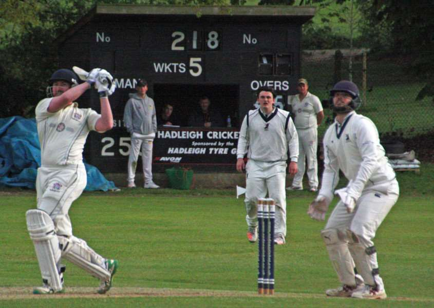 AWAY DEFEAT: Hadleigh's Tom Piddington pictured lofting Haverhill's Anthony Phillips over the boundary for six during Saturday's Marshall Hatchick Two Counties Championship Division One season opener at Friars Road