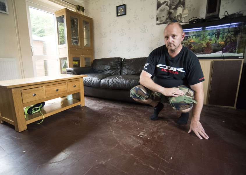 Shawn Novell has had to throw out carpets after his home was flooded by a burst water main.'Picture Mark Westley