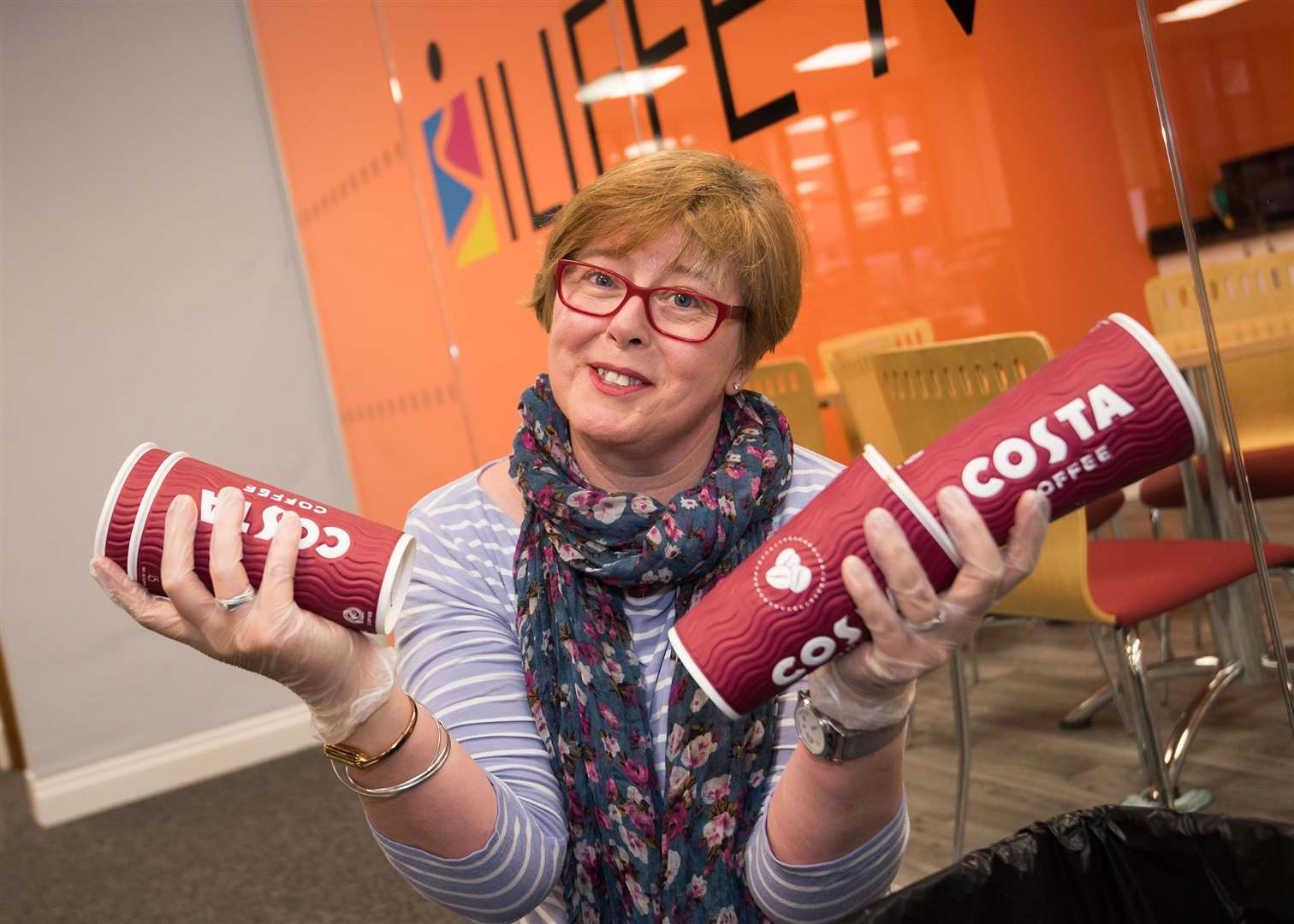 Karen Cannard with the coffee shop cups she found in the Bury Free Press binsPicture Mark Westley