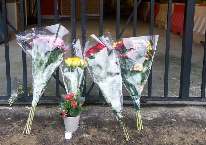 Tributes left at the Parkway multi-storey car park in Bury St Edmunds ANL-141118-094130001