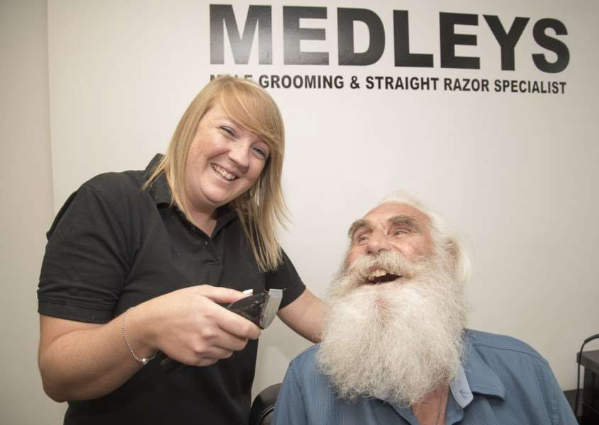 Charity hair and beard shave for Michael Howard at Medleys in North Street Sudbury, Odette Medley with the clippers helped by her brother and shop owner Sonny, 'Picture Mark Westley ANL-160830-170312009