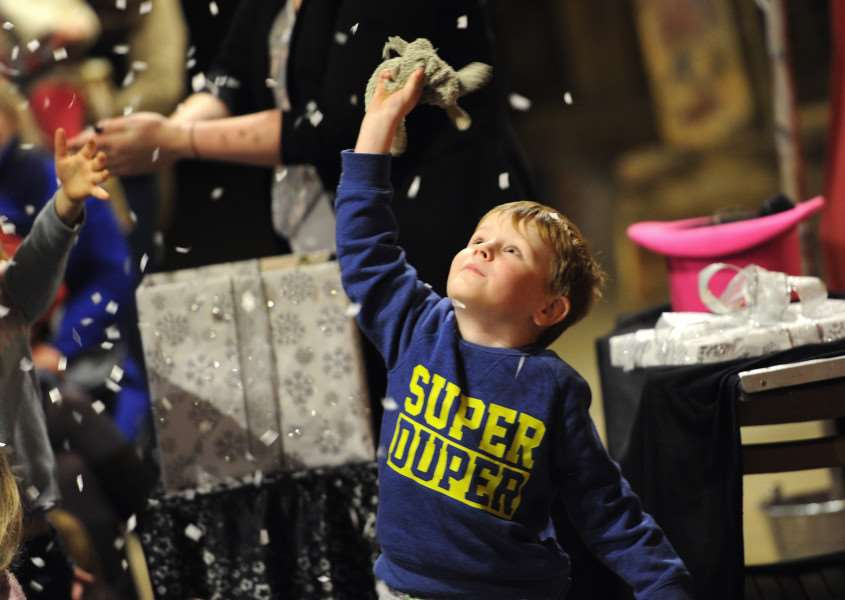 Cooper Flurrie (4) dancing in the snow during the magic show