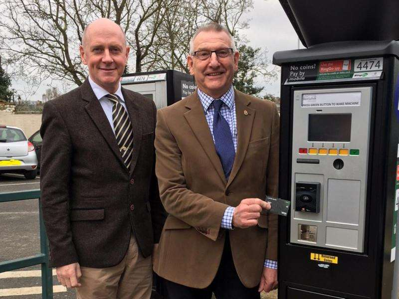 Cllrs Lance Stanbury and David Bowman demonstrate the new pay-by-card machines
