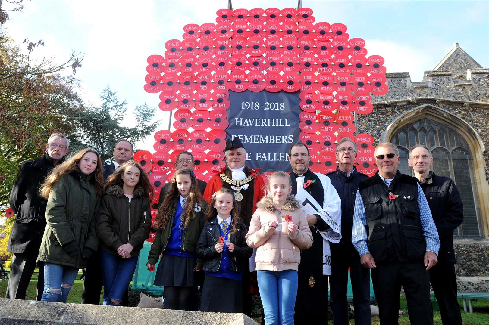 The Haverhill RBL and Local History Groups have worked with local schools to make 144 poppies, one for each of the town's WWI soldiers that died. Each poppy gives the man's name and age when they died and they are put together to form the shape of a giant poppy. ....PICTURE: Mecha Morton... .. (5056924)
