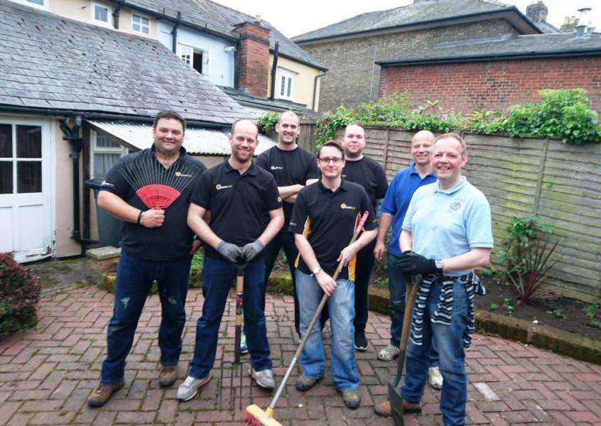 Members of Sudbury Round Table helped clear the Kernos Centre's courtyard. ANL-160106-091412001