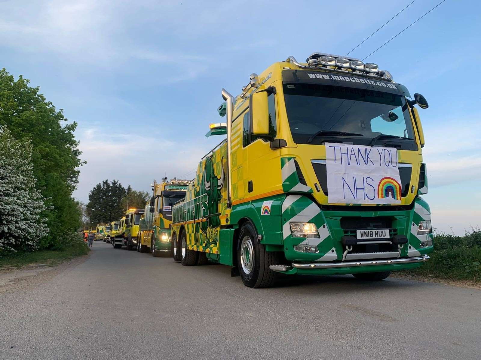 Manchetts Recovery Service trucks drove in a convoy through Burwell to celebrate all of the key workers in the village (33977077)
