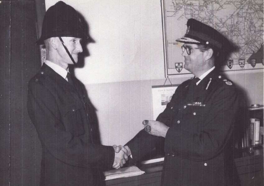 Verdun Buck being presented with his original medal