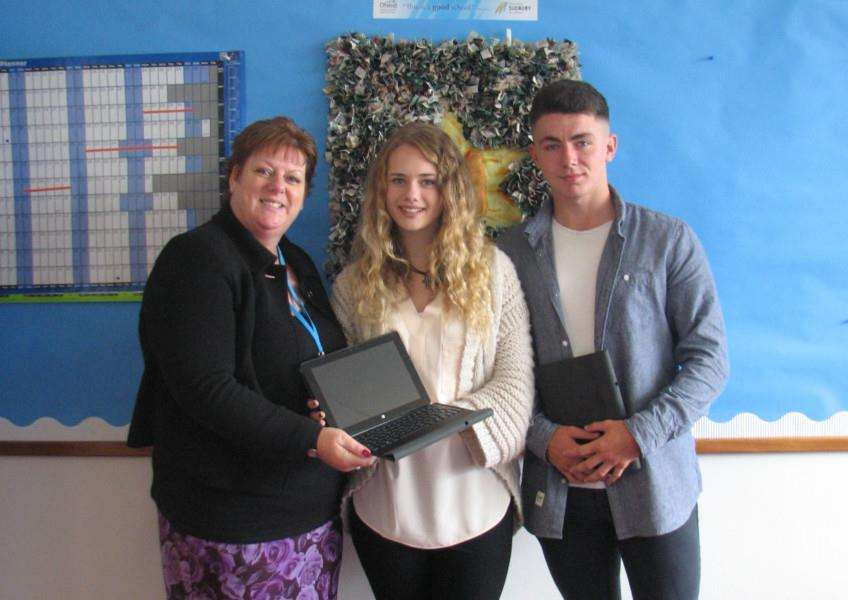 Mitchell Gardiner and Georgia Studholme receive their new tablets from Ormiston Sudbury Academy principal Caroline Wilson (left) ANL-150309-132306001