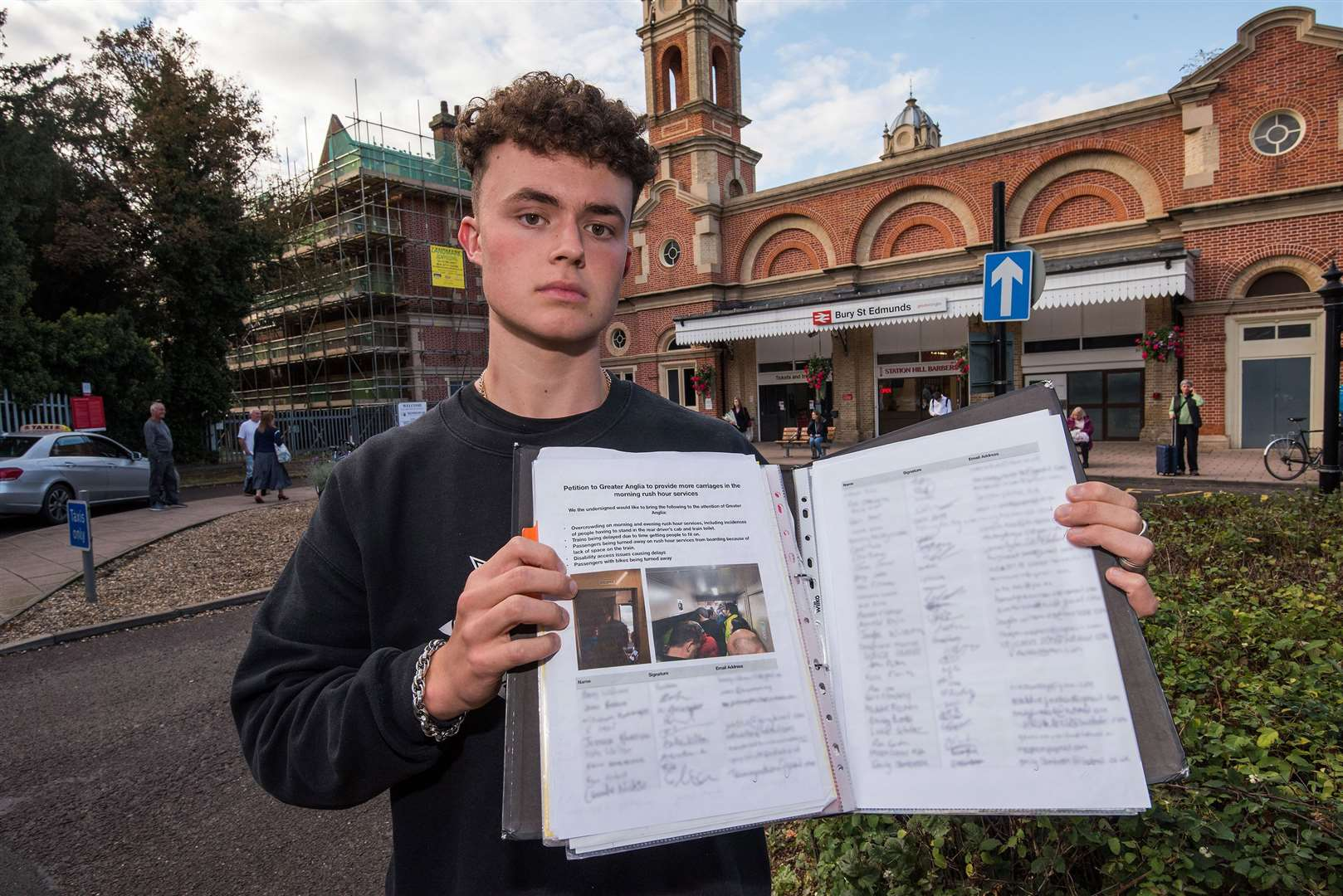 Oscar Hedge with his petition outside Bury St Edmunds railway station