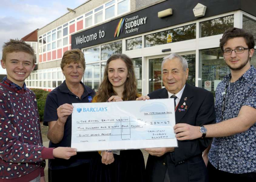 Sudbury, Suffolk. students and members of the Royal British Legion with a cheque for money raised through the Festival of Remembrance at the school in 2014 pictured from left Adam Hicks, Cynthis Hume, Chloe Ames, Stuart Hume and Jody Brown ANL-141117-175126009