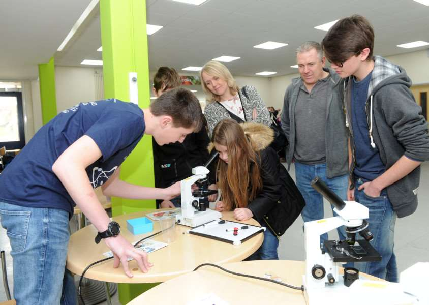 Science Festival at County Upper School ''Pictured: The Knight family looking at different things under the microscope ANL-160320-183947009