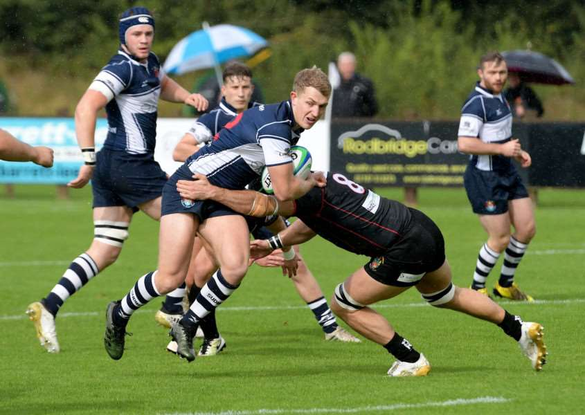 DETERMINED: Charles Jackson tries to find a way through a well-organised Rochford defence