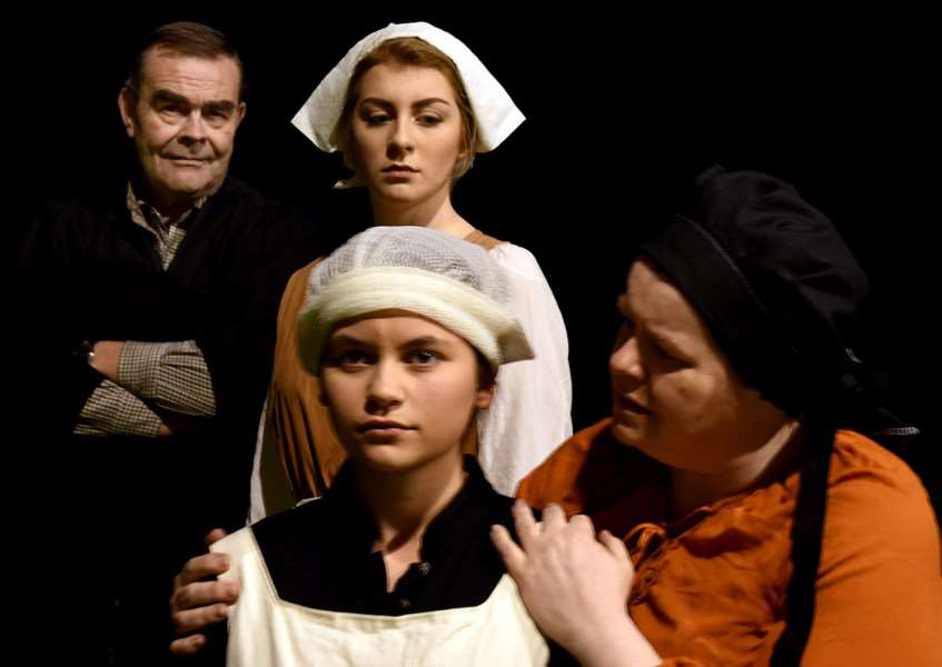 Moody: Members of the Irving Stage Company ready to stage Arthur Miller's iconic play The Crucible at the Theatre Royal in Bury St Edmunds.' Faye Smith, Honor Balaam and Christian Jenner as Abigail Williams, Betty Parris and Tituba ANL-160229-130734009