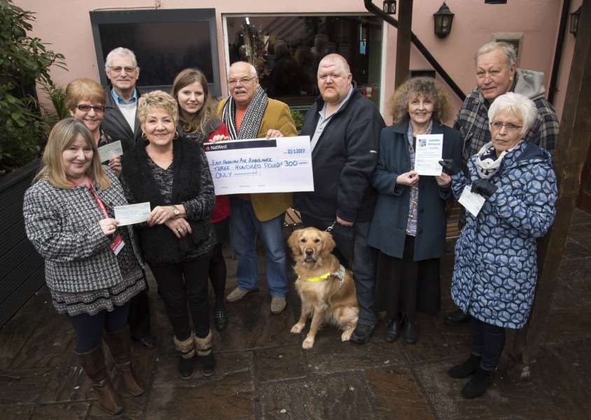 Sudbury fundraisers who organised the car park dance as they hand over cheques to local charities they have supported.'Picture Mark Westley