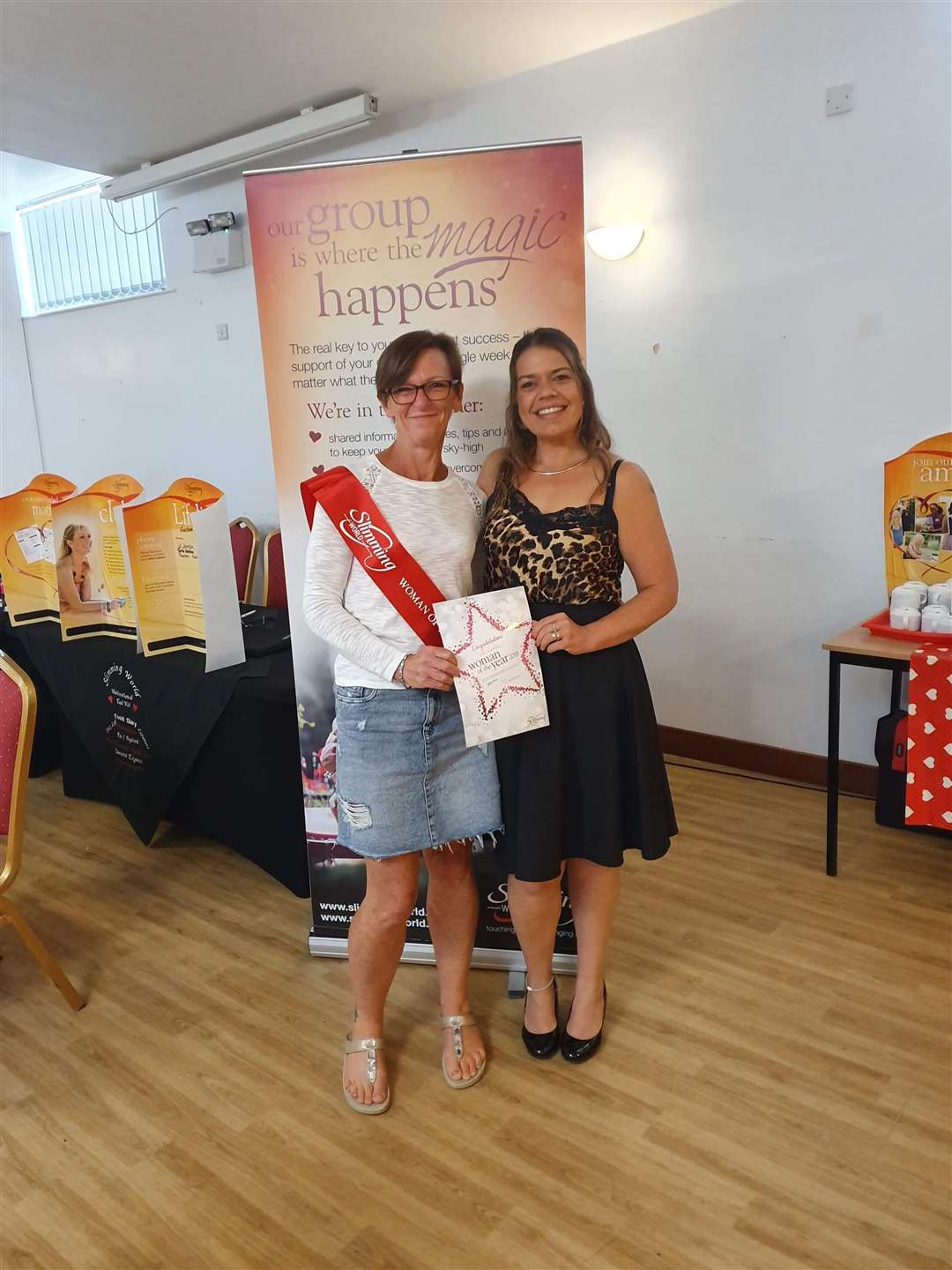 Jo Ludlow receives her Haverhill's Slimming World Woman of the Year 2019 award from her weight loss consultant Jo Johnson. Contributed picture