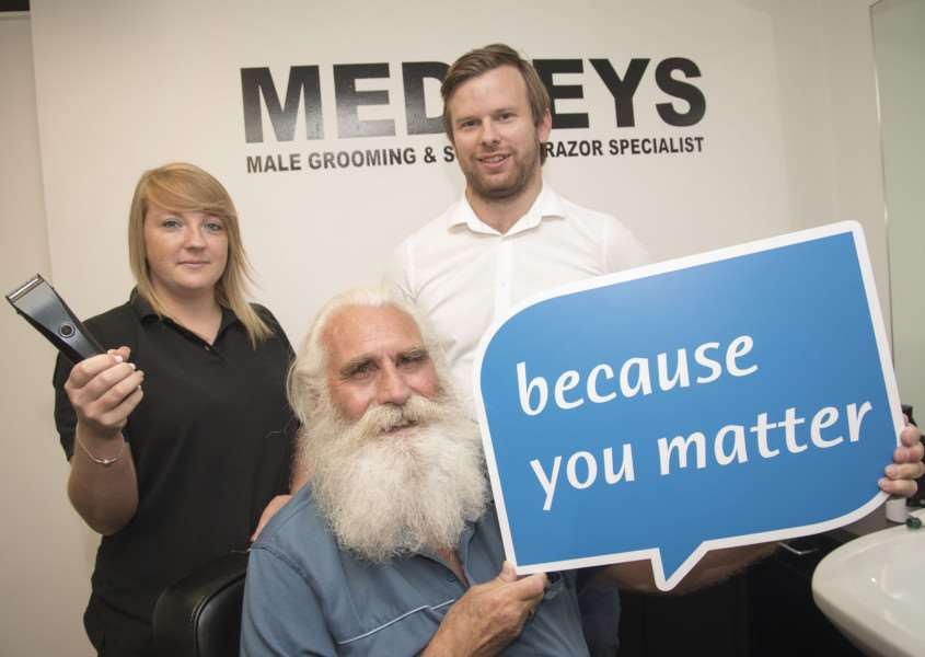 Charity hair and beard shave for Michael Howard at Medleys in North Street Sudbury, Odette Medley with the clippers helped by her brother and shop owner Sonny, George Chilvers Community Fund Raiser from St Nicholas Hospice.'Picture Mark Westley ANL-160830-170300009