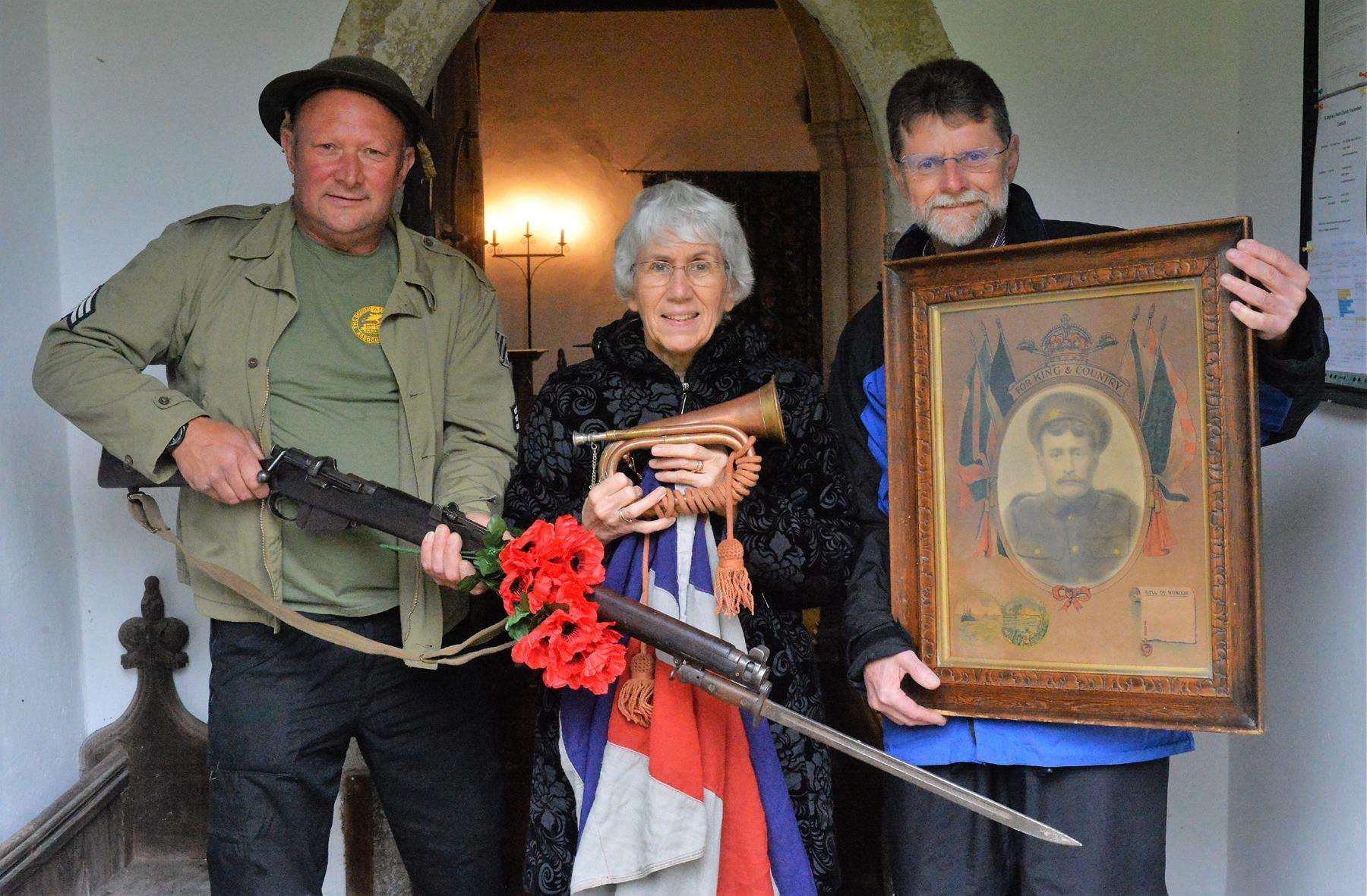 Mick King, Brenda Knowles and John Leitch display some of the many items on show at an exhibition of World War One memorabilia at St Andrew's Church, Freckenham. The exhibition continues until 5pm on Sunday and can be viewed after the 10.45am remembrance service at the war memorial inside the church gates when wreaths will be laid and the two-minute silence observed.
