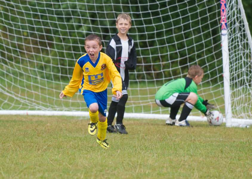 CELEBRATION TIME: An AFC Sudbury Under-9s player wheels away after scoring against Long Melford