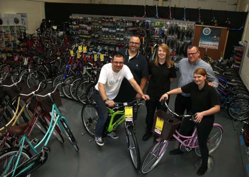 Cycle King opens the doors to its new home in Bury St Edmunds. L-R: Craig Adcock, Tony Williams, Meg Smith, Darren Hunt (MD) and Kirsty Payne.