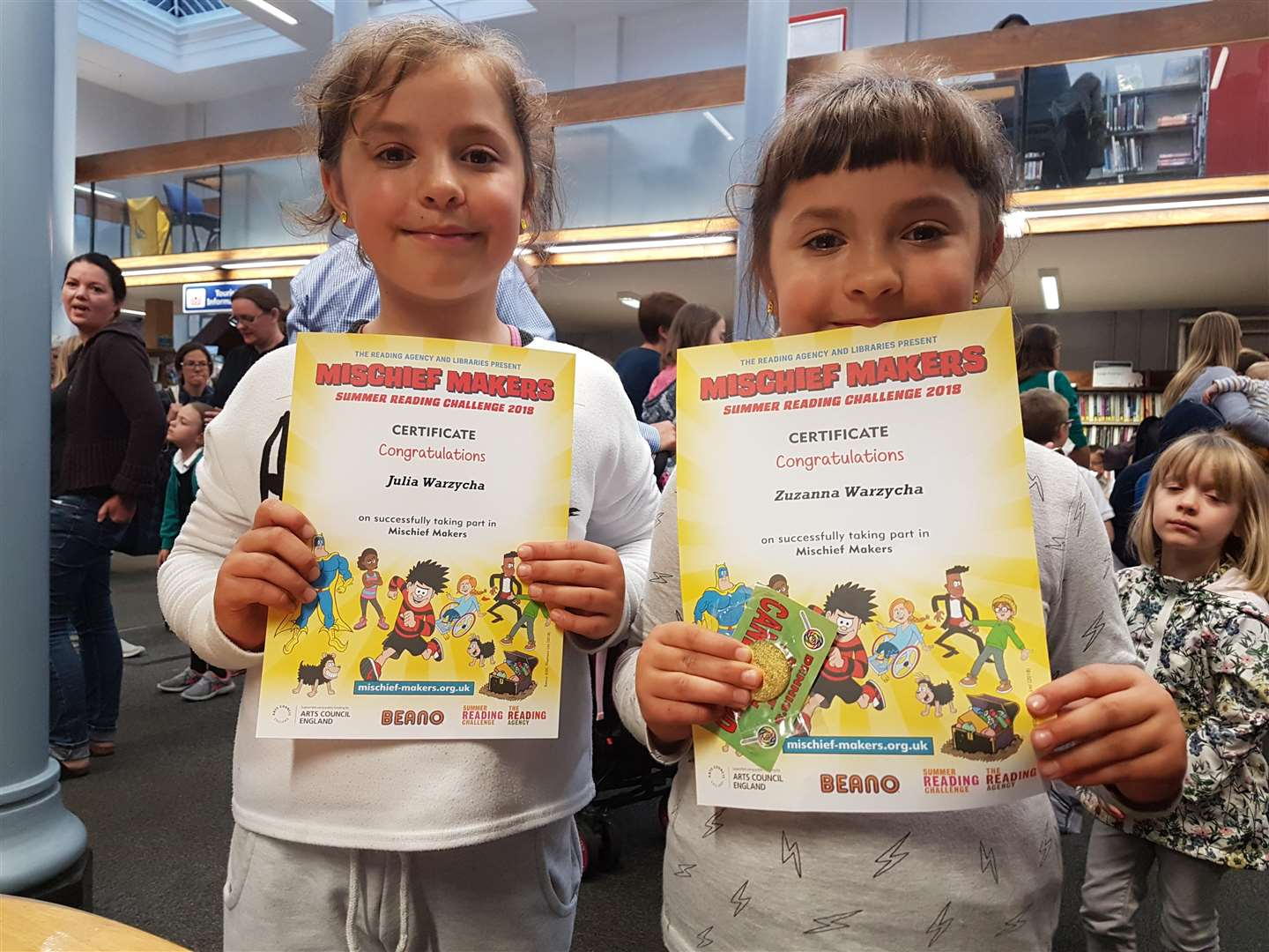 Suffolk Libraries Summer Reading Challenge 2018 - Julia and Zuzanna Warzycha receive their certificates at Sudbury Library. (4476884)