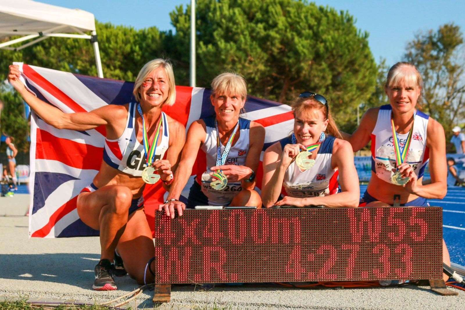 Christine Anthony (second left) with her W55 4x400m record breaking Team GB team-mates. The 4 woman team broke a 9 year record with the run at the European Masters Track and Field Championships Venice 2019. Picture: Contributed (18214553)