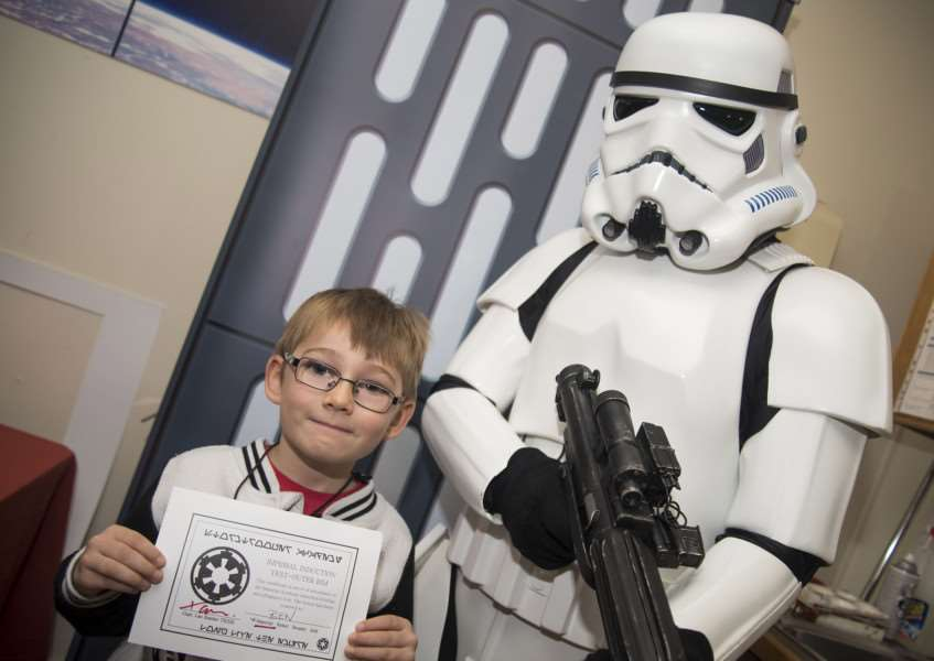Stormtrooper TK-335 meets young vistors to Moyse's Hall Bury St Edmunds Sci-Fi exhibition.'Ben Stone from Clare with TK-335'Picture Mark Westley ANL-161026-163946009