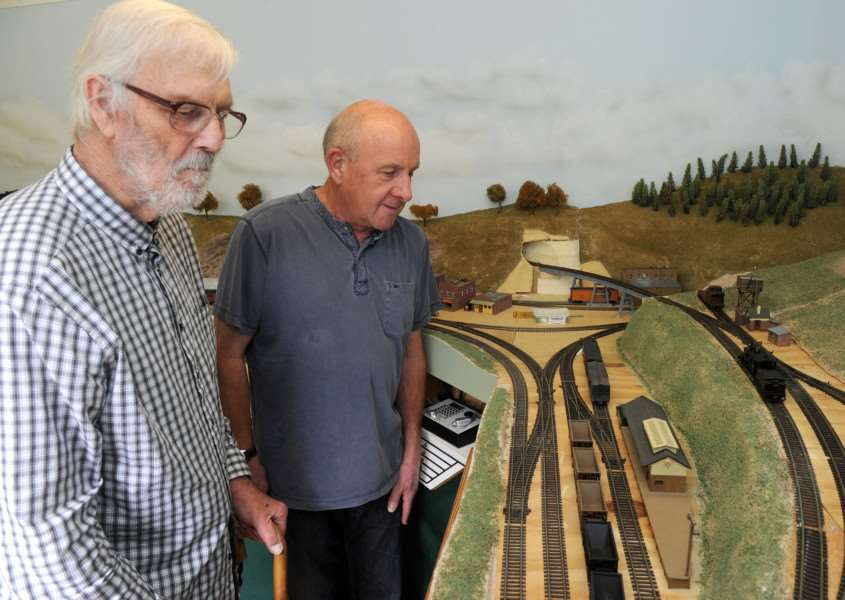 Fornham All Saints open gardens''Pictured: Jerry Lewis and Tony Robillard looking at a model train display ANL-160626-195915009