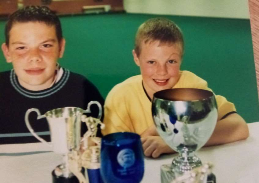 These two young chaps look as though they won some bowling trophies back in May 2000, but do you know what they were and who these two are?
